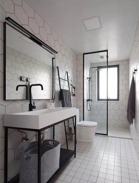 industrial bathroom idea with white ceramic tile floors walk in shower with clear glass partition hexagon tile walls large sink in white huge vanity mirror with black mirror white toilet