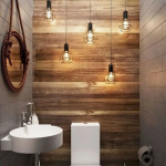 Industrial Bathroom Idea With White Toilet Wall Mounted Sink In White Wooden Like Wallpaper White Ceramic Floors Gray Tile Walls Industrial Pendant Lighting Fixtures