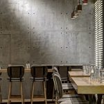 Interior Cafe With Beton Wall Panels Modern Industrial Stools Wooden Tables
