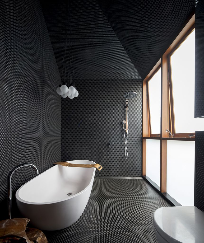 luxurious bathroom design in black white modern white bathtub free standing faucet small tile floors and walls white bulb lamps