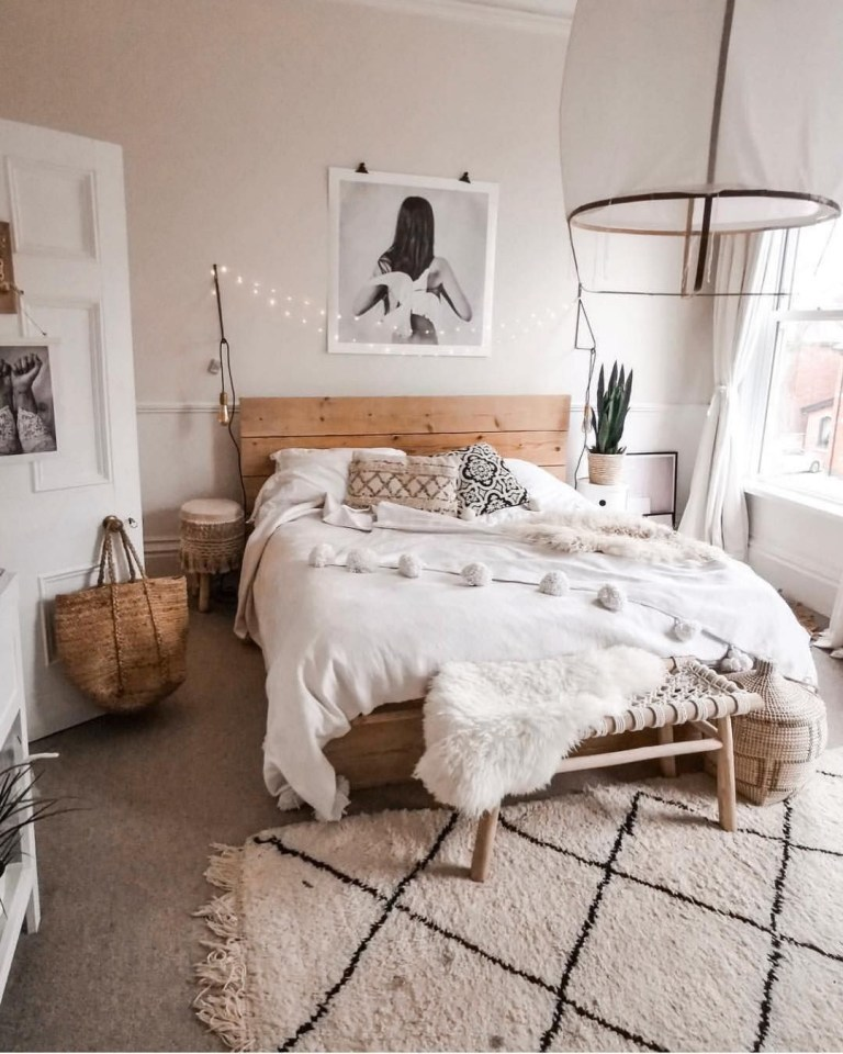 minimalist bedroom with Bohemian touch like string lamps as headboard's decoration minimalist white area rug oversized light fixture with fabric lampshade throw shag blanket in white