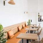 Minimalist Coffee Shop Interior Idea With Wood Bench Seat With Backrest Small Wood Tables Chairs With Thin Blacl Metal Frame And Woven Seater And Backrest
