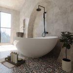 Minimalist Industrial Bathroom With Black Metal Hardware Purely White Bathtub Vintage Tile Floors Smooth Surface Concrete Walls Greenery
