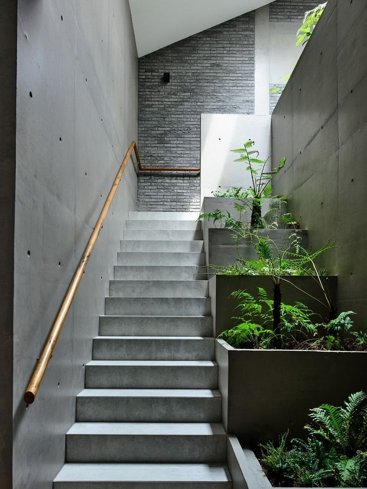 modern industrial interior staircase with mini garden