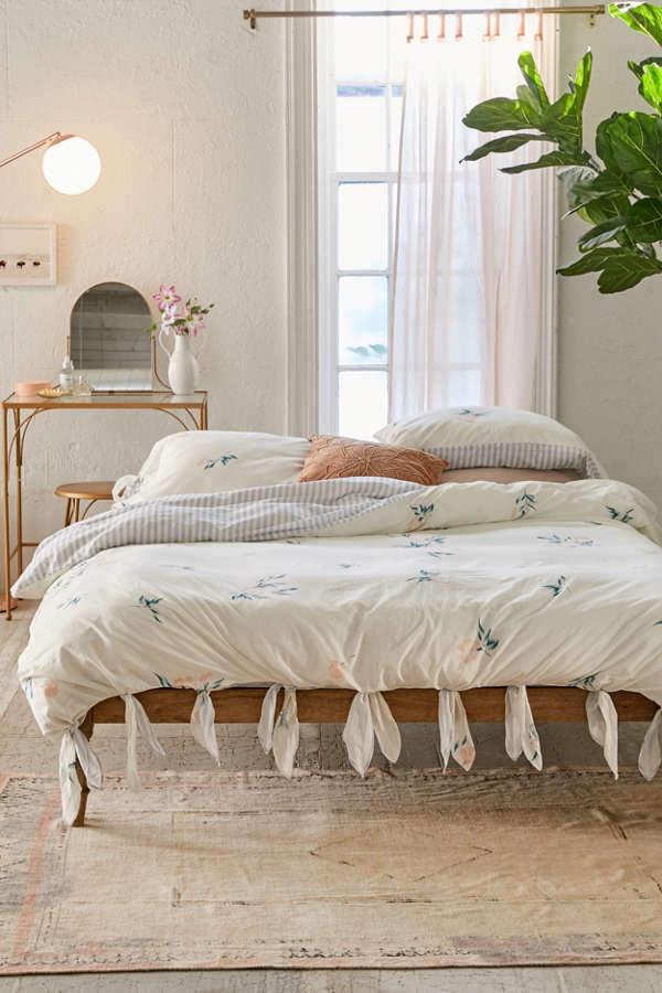 modern minimalist bedroom with white floral duvet cover shabby white runner