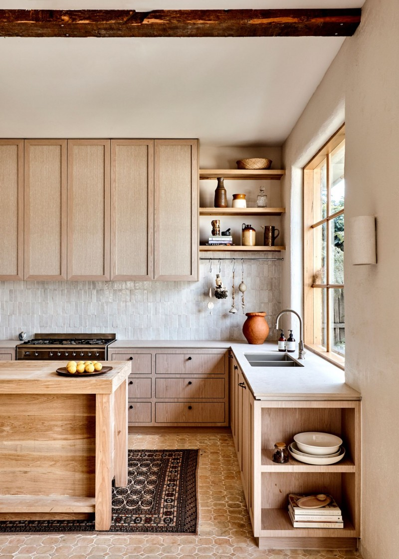 modern rustic kitchen design with light wood cabinetry white ceramic backsplash terracotta tile floors wood kitchen island