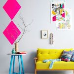Neon Yellow Couch With Tufted Cushion Back Round Top Side Table With Blue Legs