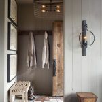 Rustic Mudroom With Wooden Bench Hardwood Front Door Hard Stone Tile Floors
