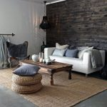 Small Sitting Area With Modern White Sofa Wooden Coffee Table Woven Pouffes Flat Woven Rug Director Chair Concrete Floors