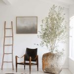 Wabi Sabi Interior With Ornate Ladder Rack Corner Chair With Wood Frame And Black Leather Cushion Ornate Stone For Greenery