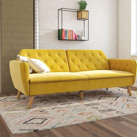 yellow sofa with tufted cushion back Scandinavian style area rug white brick walls modern industrial  bookshelf
