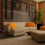 Amazing Living room With Brown Curtain Beside Plant Corner As Nicely Orange Cushions On Beige Leather Sofa Alongside With Brown Carpet Masking Floor And Wooden Wall Panel Design
