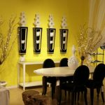 Awesome Yellow Eating Area Paint Colour Concepts With Modern Furniture Set Also White Eating Desk Plus Black Dining Chair Alongside With Art On The Wall