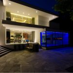 elegan architectural lighting glasses wall with full blue light stoned fool outdoor garden