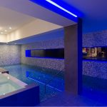 elegant swimming pool with amazing blue lighting sguare glasses window indoor swimming pool