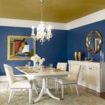 fascinating blue eating room paint colour thought with fancy chandelier white eating desk plus modern dining chair fur rug including spherical mirror on the wall
