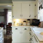 minimalist-white-wooden-vernished-kitchen-set-minimalist-wooden-cabinet-white-round-pendant-lamp-brown-wooden-dining-table-brown-wooden-dinning-chair