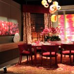 red elegant dining room inspiration red vernished wooden dining chair red vernished dining table dining room rug with oriental ornament eriental pendant lamp abstrac dining room painting