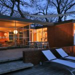 Fashionable Architecture Utilizing Glasses Wall plus Door White Lounge Chairs Outside
