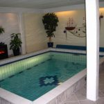 Small Indoor Swimming Pool concept with Fashionable Hearth In Poolside