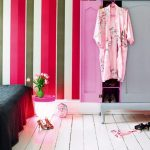 White Wood Flooring Apartment With Black Blanket Bed room plus Colourful Stripes Wall Decor With Pink Brown Cream Coloration With Pink Wooden Cupboards And Floor Lighting