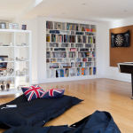 amazing boys lounge with interesting union jack cushion and interesting large wall mout bookshelves also elegant student desk with laminate floor design