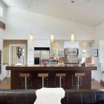 amazing brown and white kitchen accent with gorgeous brown iron barstool and interesting buil-in living area with magnificent pendant lamp in hardwooden flooring