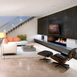 Amazing Modern Living Room Design With Wonderful Black Wall Panel Also Cozy Leather Soda With Shocking Orange Cushions In Glossy Granite Flooring Concept