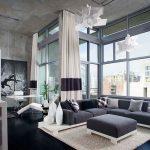 amazing modern masculine living room cozy warm black loft sofa wonderful large iron framed wall interesting office desk with hardwooden varnished flooring