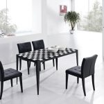 awesome Black plus White Pattern Dining Desk and Black Leather-based Eating Chair As Well White Self-importance plus Shelves Beside Huge Glass Window Together with Plant Corner area