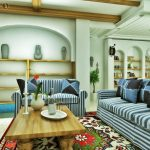 awesome Blue Pillow As Properly Picket Desk On Floral Rug Including Picket Shelves On The Wall amazing Small Dwelling Room decoration beautiful Striped Sofa
