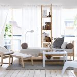 awesome Lounge Chair plus Small Sq. Table On Rug also Small Bedding Also White Sliding Curtain Gorgeous Living Room Inside Design With Wonderful Distinctive White Chair On Wood Floor