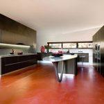 awesome Orange Floor Together with Distinctive Shaped Kitchen Island plus Bar Stools Modern Kitchen Lighting Ideas Beneath Cabinet