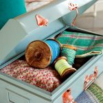 beautiful light blue storage like luggage with orange lockspink floral fabric turquoise pillow sheet blue ribbon roll green and white yw=ellow ribbon roll