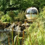 beautiful natural river small waterfall amazing scenery great garden globe shaped structure round sitting place with metallic and glass construction