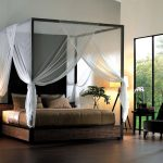 black chair black side table woven and white table lamp black small side table black vase white mosquito net gold and silver bedding set black woven canopy bed white floor lamp