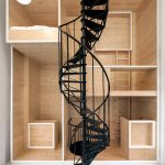 black spiral staircase wooden living structure wooden sleeping space wooden sink area small woosedn ladder white ceramic floor white simple pendant lamp unique living space design