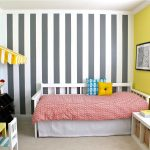 blue and white stripes painted wall yellow painted wall light turqoise painted wall white wooden daybed frame creame carpet white painted ceiling white wooden cases small colorful chairs and table