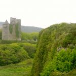 breathtaking ballinalacken castle in ireland strong stone wall narrow rectangular windows beautiful green scenery castle in natural surrounding old mideval castle