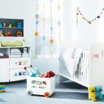 cheerful white wall white wood crib light blue wood flooring white wardrobe white framed window grey open shelf animal dolls wood train toy colorful wall decoration