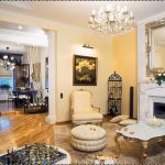 classic Interior Decorations With Crystal Chandelier In High Ceiling Additionally White Gold Desk Fur Rug Mirror Wall Mount Hearth Mantel Additionally Picket Ground