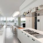 cozy interior Design In White Kitchen set Lighting Stove Also Double wash basin Timber Glass Wall