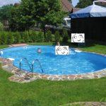 Curvy Swimming Pool Stone Pool Side Green Refreshing Grass Well Groomed Yard Small Swimming Pool Idea