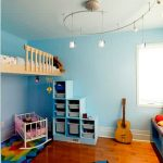 cute blue kids room with modular storage and cute window seat also uniqe floating bed with colorful mini rug in lamiante flooring