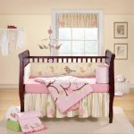 cute eco friendly nursery design wood bed hardwood flooring cream wall white framed window white hanging coat rectangular white rug pink and cream bedding set with natural picture