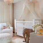 cute nursery room with elegant white crib and gorgeous crystal chandelier magnificent white sofa cute elephant furniture warm large fur rug