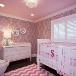 Cute Pink Nursery Room With Flowery Pattern Wallpaper Also Extravagant Chandelier With Lage White Crib Also Magnificent Rattan Wastebasket In Granite Flooring Ideas