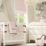 cute white crib white board wall white chandelier white mosquito net pink curtain white hanging shelf white wood wardrobe white framed window