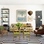 elegant apartmenet living room with gorgeous black and white rug and cozy leather armchair also cozy yellow sofa with gorgeous painting and interesting floor lamp in hardwooden flooring