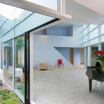 elegant black piano indoor garden litle cream sofa elegant glasses wall